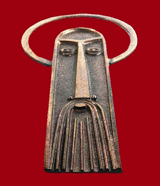 Ancient man mask made of bronze