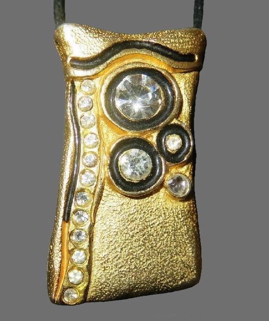 Purse shaped gold tone pendant. Gold tone, rhinestones, enamel