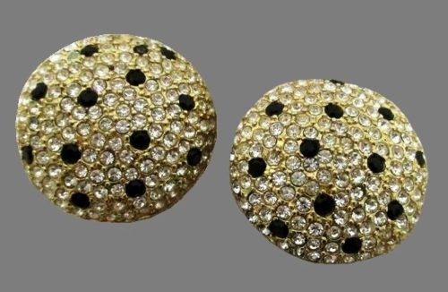 Round clip on earrings. Pave crystals, gold tone alloy, black dots