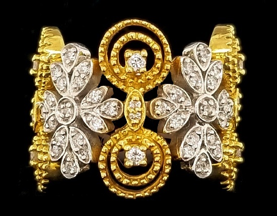White and yellow gold floral design ring encrusted with 0.65 ct diamonds