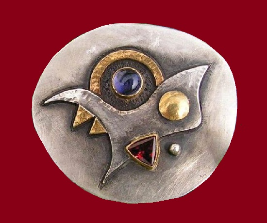 Abstract design brooch. Silver, gold, iolite, Garnet. 2006