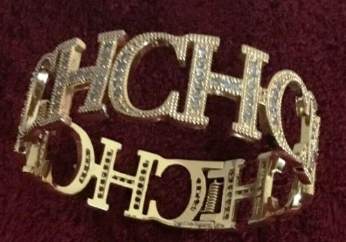 Brand's logo CH bracelet of gold tone, crystals