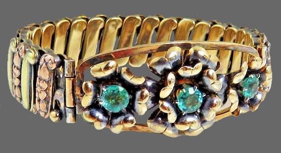 Floral design sterling silver bracelet, greenish rhinestones