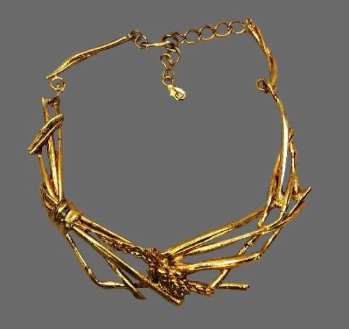 Grass motif statement necklace of gold tone