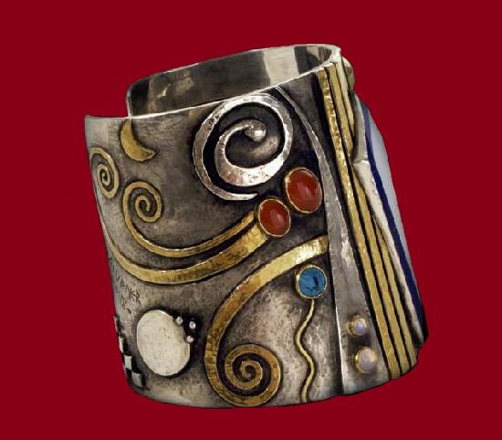 Intermezzo cuff bracelet, 2009. Silver, gold, Lapis Lazuli, carnelian, Turquoise, moon stone