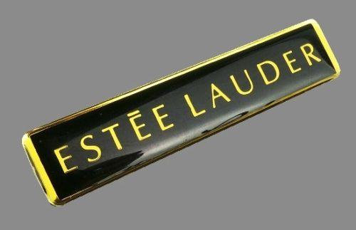 Logo gold on black background brooch