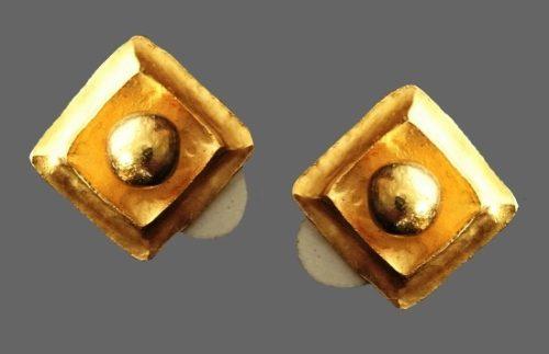 Modernist design earrings of gold tone