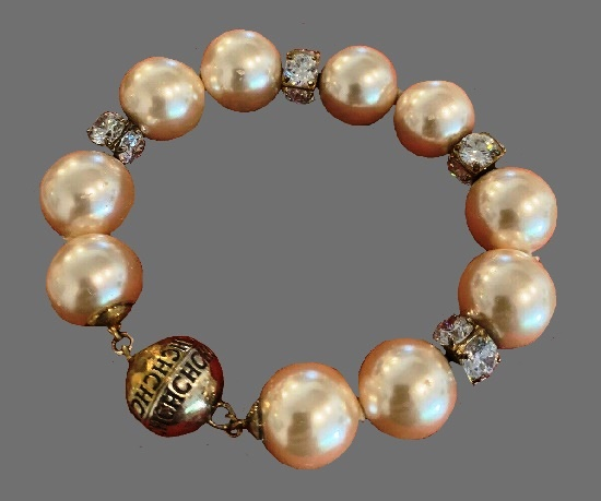 Pearl bracelet, gold tone metal, crystals