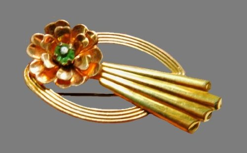 Retro flower brooch of gold tone with rhinestones
