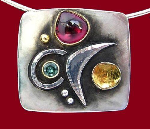 Universe pendant. 2018. Garnet, Green Tourmaline, silver and gold. 3 cm