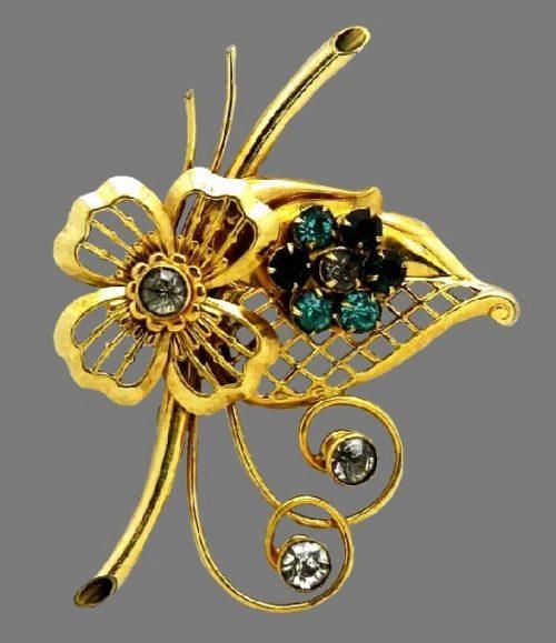 Yellow gold and rhinestone flower brooch. 12 K gold filled, rhinestones