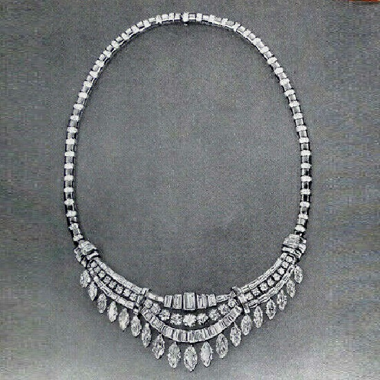 Diamond necklace - Baguette, round and marquise diamonds. Flexible platinum mounting with alternate links studded with diamonds. $22.500