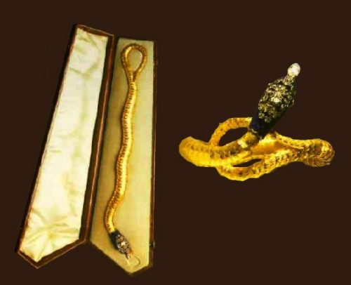 Gold bracelet with enamel and diamonds. Circa 1840. Rare original case in the form of a coffin. Pear-shaped diamond hanging from the mouth of a snake