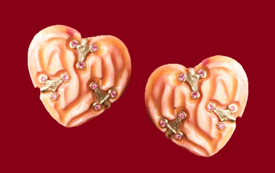 Heart shaped 1970s clips. Jewelry alloy of silver tone, plastic of cream color
