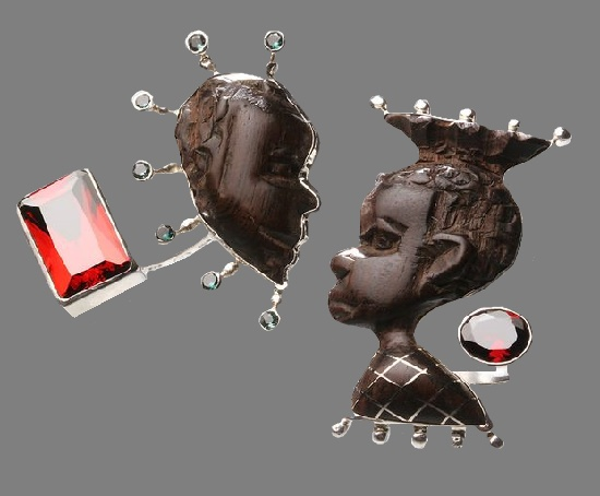 Paired brooches of silver