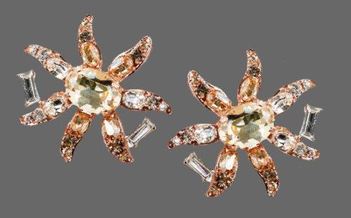 Pierce earrings. Star flower design, pink crystals, gold tone metal