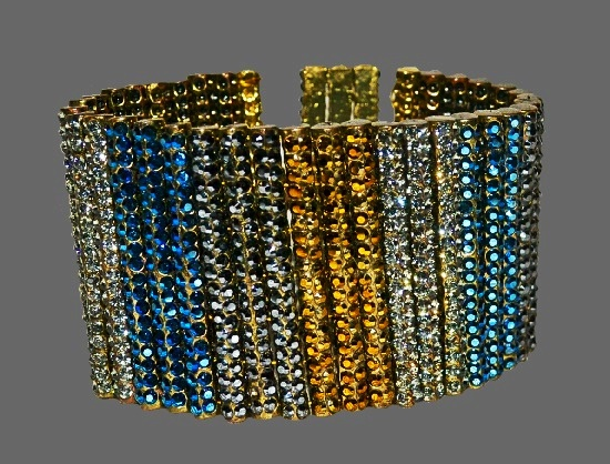 Shimmering line bracelet. Brass tone metal, blue, black, clear and topaz Swarovski crystals