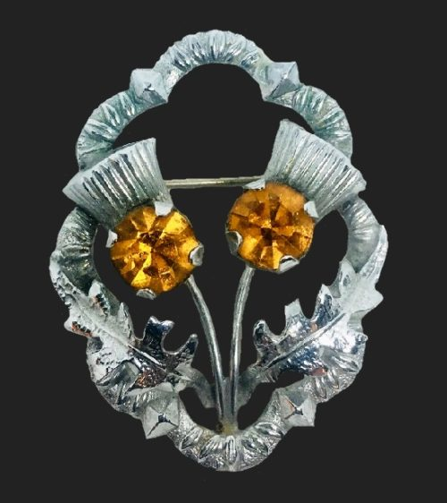 Silver tone amber color rhinestones Thistle Pin