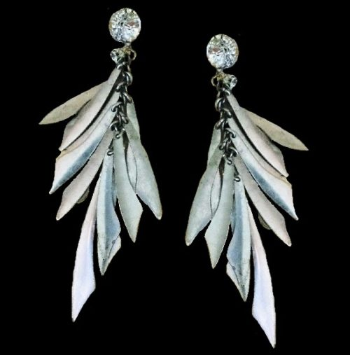 Silver tone metal dangle dagger earrings with crystals