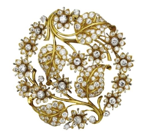 The openwork circular motif of floral and foliate design, set with 193 round diamonds, signed John Rubel Co