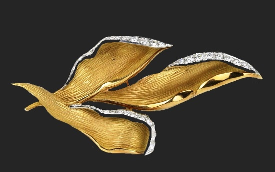 Three leaf brooch. 1.7 carat diamond, 18K gold