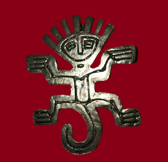 Tribal man design silver tone brooch