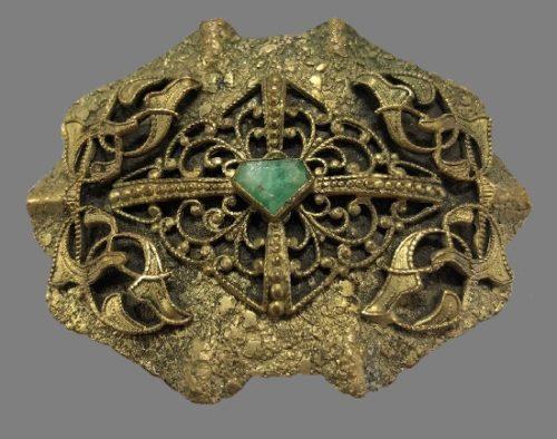 Victorian style brassfiligree brooch, malachite insert in the center