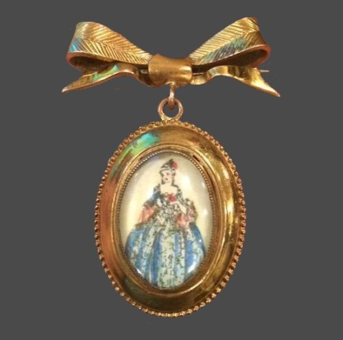 1930s pendant brooch. Under convex glass is miniature lithography of a lady with crinoline