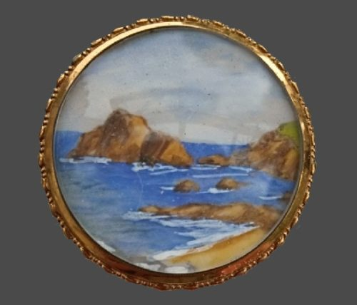 Amazing antique brooch with a miniature depicting the sea and rocks, painted by the artist. 4 cm