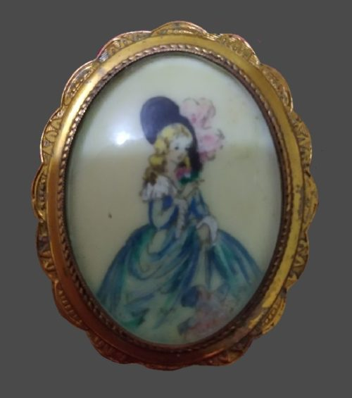 Antique brooch depicting a portrait of a young lady painted by an artist. 1930s, 4.5 cm