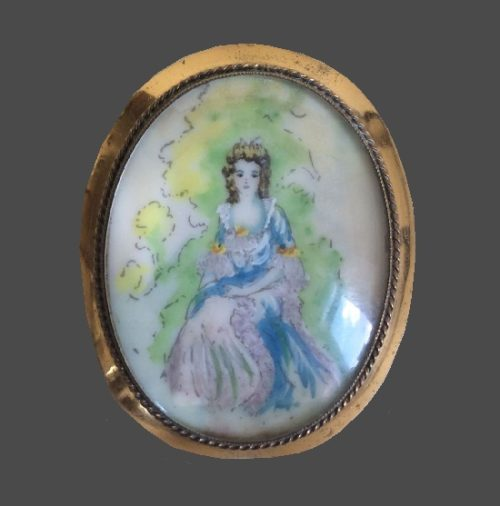 Lady in a lace dress brooch. Brass alloy, hand painted, glass. 4.8 cm. 1920s