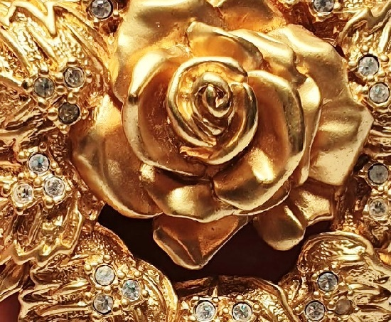Detail of Rose flower brooch. 1990s. 7 cm, gold tone metal, rhinestones