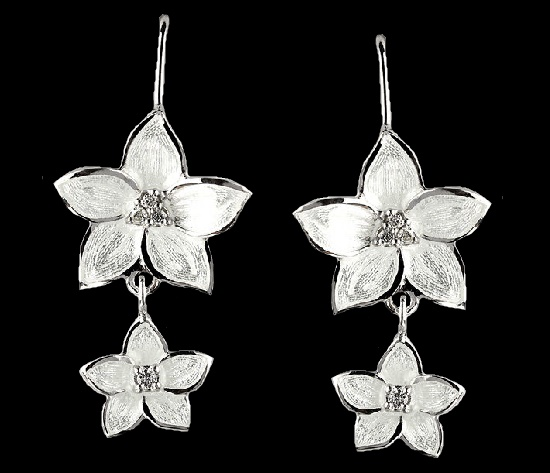 Flower dangle earrings. Sterling silver set with diamonds. Rhodium plated