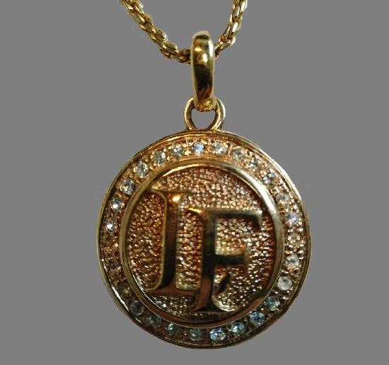 Initials LF pendant of gold tone, rhinestones