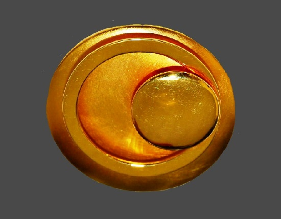 Laconic vintage brooch. Matte gold circle background with two shiny circles. 1980s