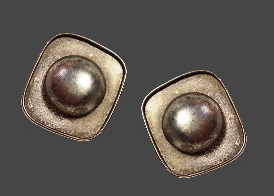 Modernist design silver tone clip on earrings