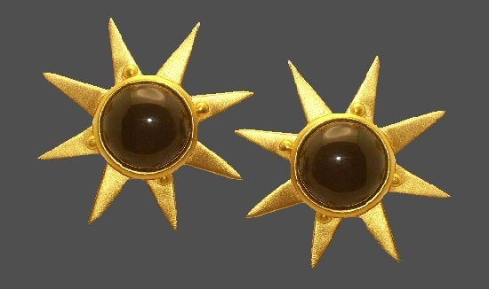 Sun ray clip on earrings. Gold tone metal, black lucite