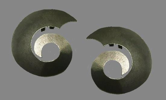Swirl shaped earrings of silver tone