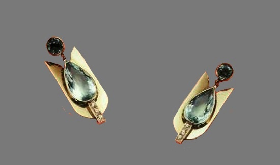 A pair of hanging earrings with aquamarines and diamonds by Raymond Templier. About 1930. Flat surfaces are characteristic for the products of this master