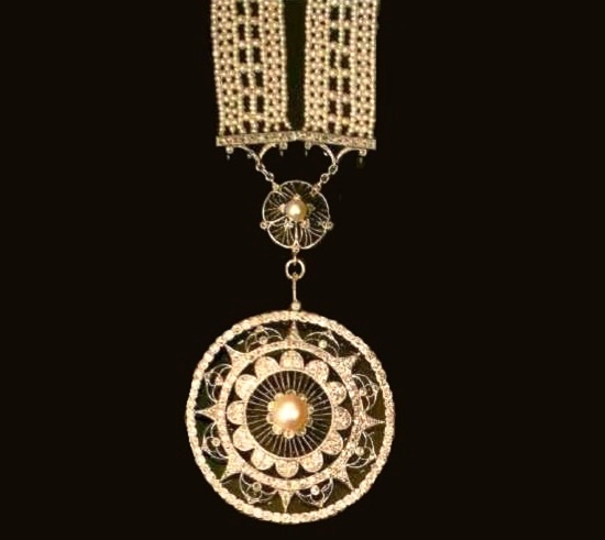 A sautoire made from small pearls with diamonds and a pendant in the shape of a rosette. 1905