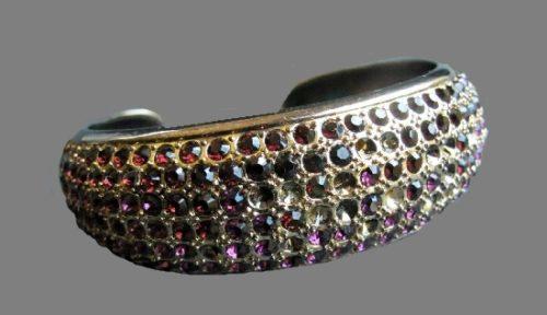 Bracelet. Gold tone metal, purple rhinestones