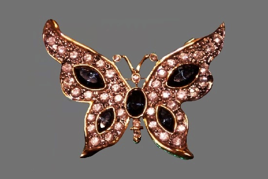 Butterfly brooch. Gold tone metal, blue and clear rhinestones