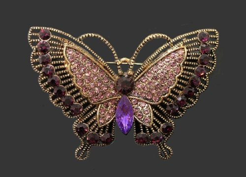 Butterfly brooch. Gold tone metal, purple crystal, rhinestones