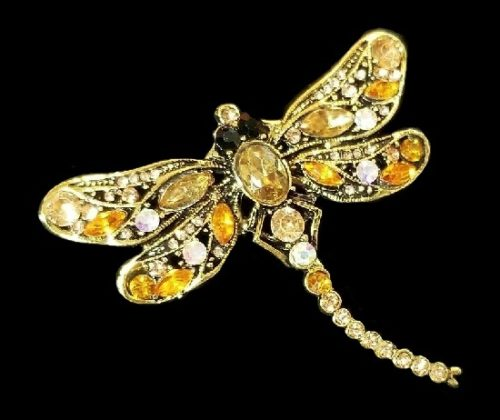 Dragonfly brooch. Gold tone metal, champagne color rhinestones