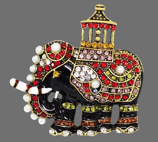 Elephant brooch. Gold tone metal, rhinestones, lucite