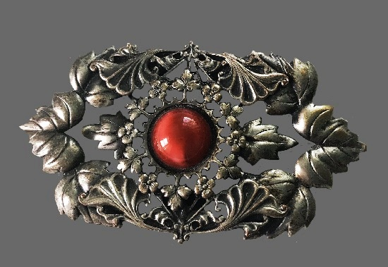 Floral design Victorian style brooch. Sterling silver, red cabochon