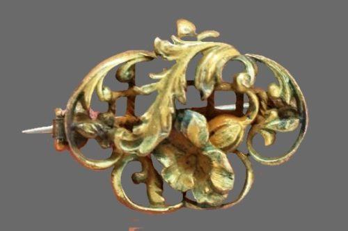 Floral design openwork brooch of bronze tone metal