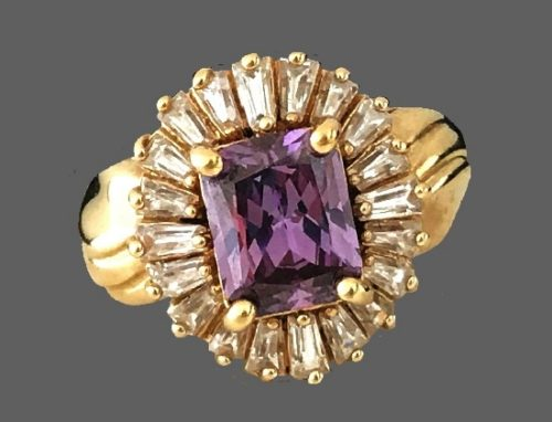 Gold tone metal ring with pink color cubic zirconia