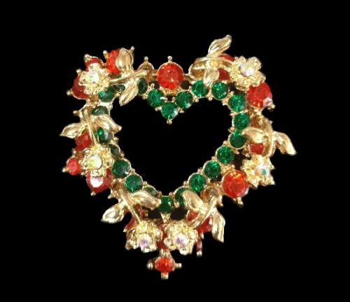 Heart shaped floral design wreath pin. Gold tone metal, red and green rhinestones