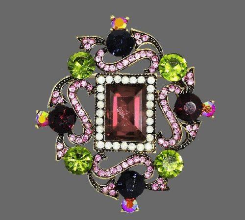 Heraldic style brooch. Gold tone metal, crystals, rhinestones